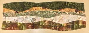 Example of 5 earth tone batiks used in a freeform table runner
