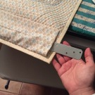 Metal tie straps used to hang quilt